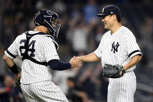 New York Yankees starter Masahiro Tanaka, right, greets catcher Gary Sanchez (24) after pitching a complete baseball game shutout against the Tampa Bay Rays, Monday, June 17, 2019, in New York. (AP Photo/Sarah Stier)