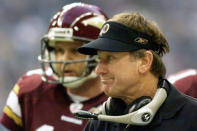 FILE - Washington Redskins coach Steve Spurrier, right, looks out at the field during the final minutes of the Redskins' 27-20 loss to the Dallas Cowboys in Irving, Texas, in this Thursday Nov. 28, 2002, file photo. Redskins quarterback Danny Wuerffel is at rear. Spurrier was 12-20 in two years at Washington before he walked away. (AP Photo/Donna McWilliam, File)
