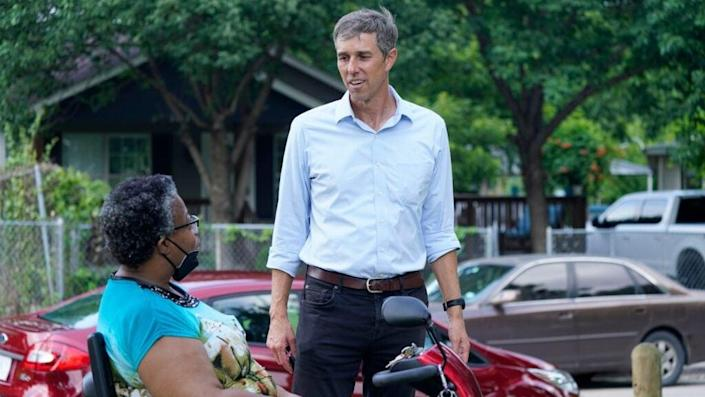 Beto O'Rourke talks to a voter in Dallas on June 9, 2021 during a canvassing effort. (Associated Press)
