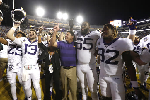 LSU head coach Ed Orgeron and his team celebrate a victory after an NCAA college football game against Mississippi State in Baton Rouge, La., Saturday, Oct. 20, 2018. LSU won 19-3. (AP Photo/Tyler Kaufman)