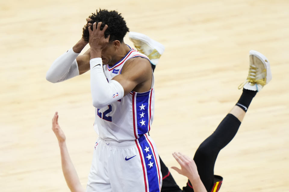 Philadelphia 76ers' Matisse Thybulle, left, reacts after fouling Atlanta Hawks' Kevin Huerter, right, during the second half of Game 7 in a second-round NBA basketball playoff series, Sunday, June 20, 2021, in Philadelphia. (AP Photo/Matt Slocum)