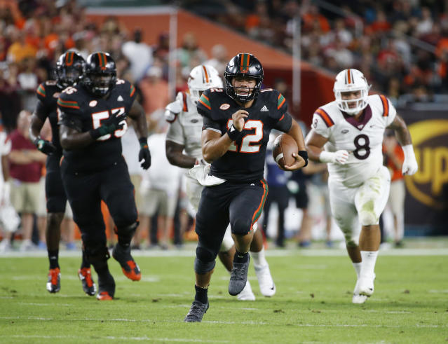 Miami quarterback Malik Rosier (12) runs for yardage during the first half of an NCAA College football game against Virginia Tech, Saturday, Nov. 4, 2017 in Miami Gardens, Fla. (AP Photo/Wilfredo Lee)