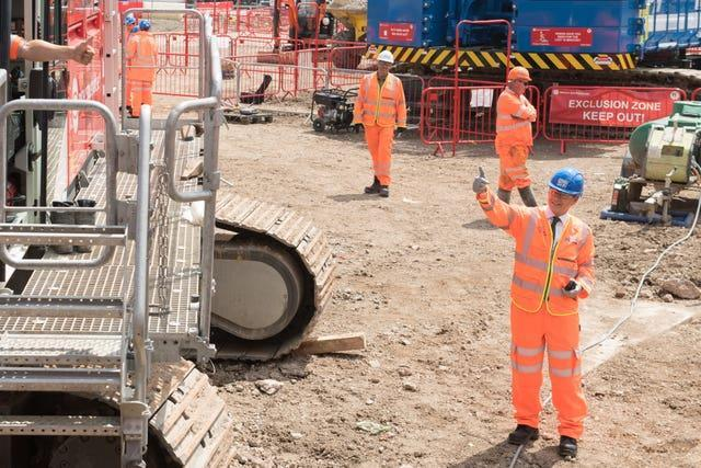 Transport Secretary Grant Shapps gives the signal for digging to begin