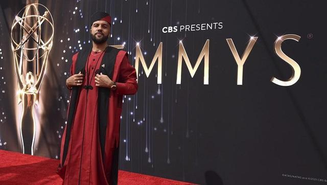 O-T Fagbenle wore a traditional Nigerian look in red with black accents by a Lagos brand, Sofisticat (AP Photo/Chris Pizzello)