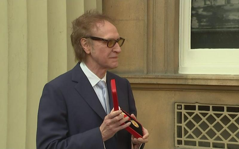 Sir Ray Davies is knighted by the Prince of Wales at Buckingham Palace