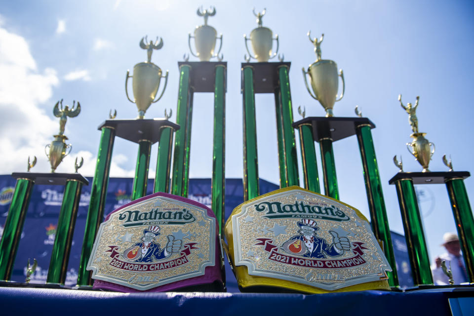 Trophies are displayed at the Nathan's Famous Fourth of July International Hot Dog-Eating Contest in Coney Island's Maimonides Park on Sunday, July 4, 2021, in New York. (AP Photo/Brittainy Newman)