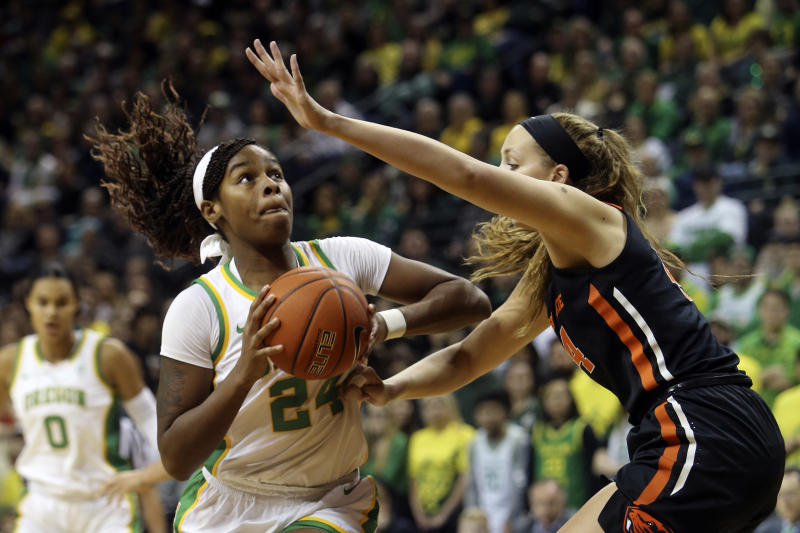 Oregon's Ruthy Hebard, left, goes up to shoot against Oregon State's Taylor Jones during the first quarter of an NCAA college basketball game in Eugene, Ore., Friday, Jan. 24, 2020. (AP Photo/Chris Pietsch)