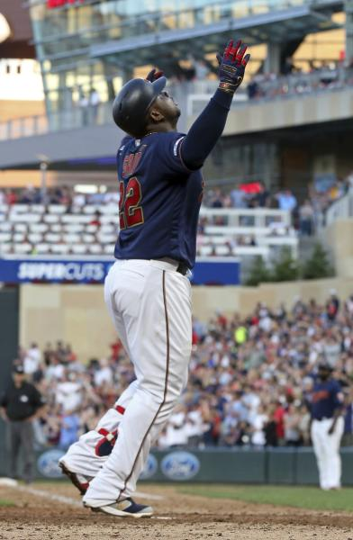 Minnesota Twins' Miguel Sano celebrates his solo home run off Oakland Athletics pitcher Brett Anderson in the seventh inning of a baseball game Saturday, July 20, 2019, in Minneapolis. The Athletics won 5-4. (AP Photo/Jim Mone)