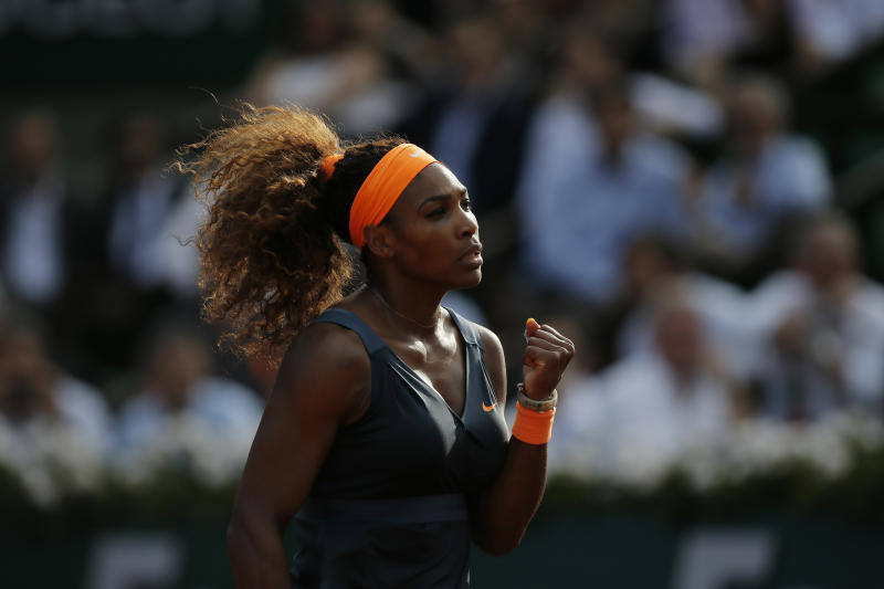 Serena Williams of the U.S. clenches her fist after scoring against Italy's Sara Errani, defeating Errani in two sets 6-0, 6-1, in their semifinal match at the French Open tennis tournament, at Roland Garros stadium in Paris, Thursday June 6, 2013. (AP Photo/Petr David Josek)