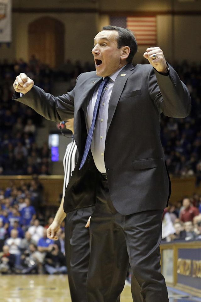 Duke coach Mike Krzyzewski reacts following a play against Florida State during the first half of an NCAA college basketball game in Durham, N.C., Saturday, Jan. 25, 2014. Duke won 78-56. Krzyzewski joins Syracuse's Jim Boeheim as the only coaches with at least 900 wins at one program. (AP Photo/Gerry Broome)