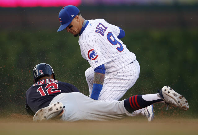 Cleveland Indians' Francisco Lindor (12) is tagged out at second by Chicago Cubs' Javier Baez trying to stretch a hit into a double during the first inning of a baseball game Wednesday, May 23, 2018, in Chicago. (AP Photo/Jim Young)