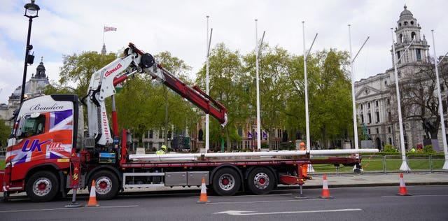 Flagpoles were erected in Parliament Square ahead of the traditional State Opening of Parliament
