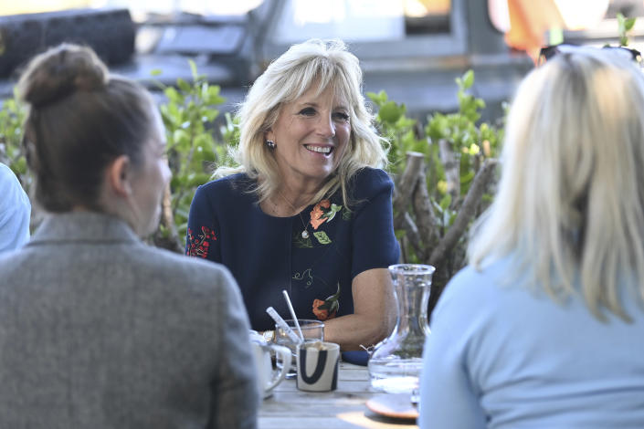 US First Lady Jill Biden smiles as she meets military surfers and their families in Newlyn, Cornwall, England, on the sidelines of the G7 summit, Saturday June 12, 2021. US First Lady Jill Biden met with veterans, first responders and family members of Bude Surf Veterans, a Cornwall-based volunteer organization that provides social support and surfing excursions for veterans, first responders and their families. (Daniel Leal-Olivas/Pool via AP)