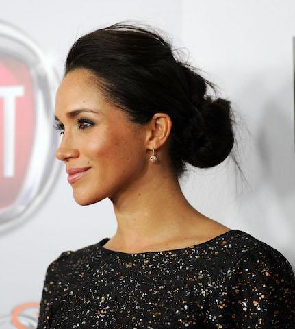 <p>At the 2013 Golden Globe Awards, Meghan mixed up her look and gave her now-famous bun a swept-back makeover. <em>[Photo: Getty]</em> </p>