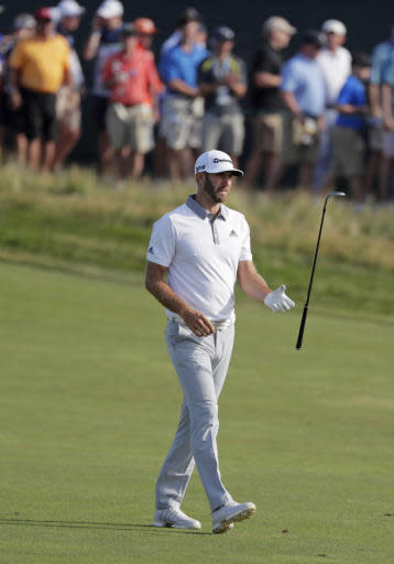 Dustin Johnson reacts after hitting an approach shot on the 15th hole during the final round of the U.S. Open Golf Championship, Sunday, June 17, 2018, in Southampton, N.Y. (AP Photo/Frank Franklin II)