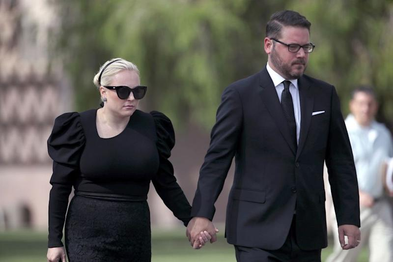 From left: Meghan McCain and her husband, Ben Domenech, at her dad's memorial in Arizona | Justin Sullivan/Getty