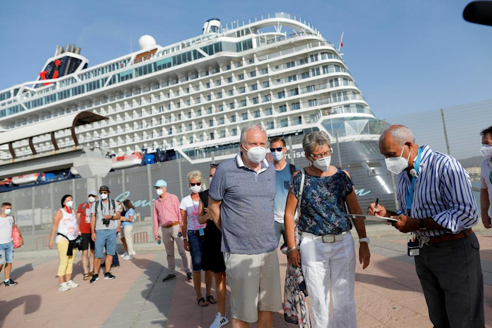 German tourists disembark for sightseeing from the cruise ship 'Mein Schiff 2' of the company TUI Cruises after it was docked at dawn in Malaga port, becoming the first cruise ship carrying tourists to arrive on Spain's mainland since June 2020, amid the coronavirus disease (COVID-19) pandemic, in Malaga, southern Spain, June 15, 2021. REUTERS/Jon Nazca