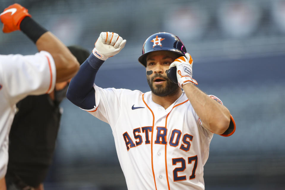 SAN DIEGO, CA - OCTOBER 13:  Jose Altuve #27 of the Houston Astros celebrates after hitting a solo home run in the first inning during Game 3 of the ALCS between the Tampa Bay Rays and the Houston Astros at Petco Park on Tuesday, October 13, 2020 in San Diego, California. (Photo by Alex Trautwig/MLB Photos via Getty Images)
