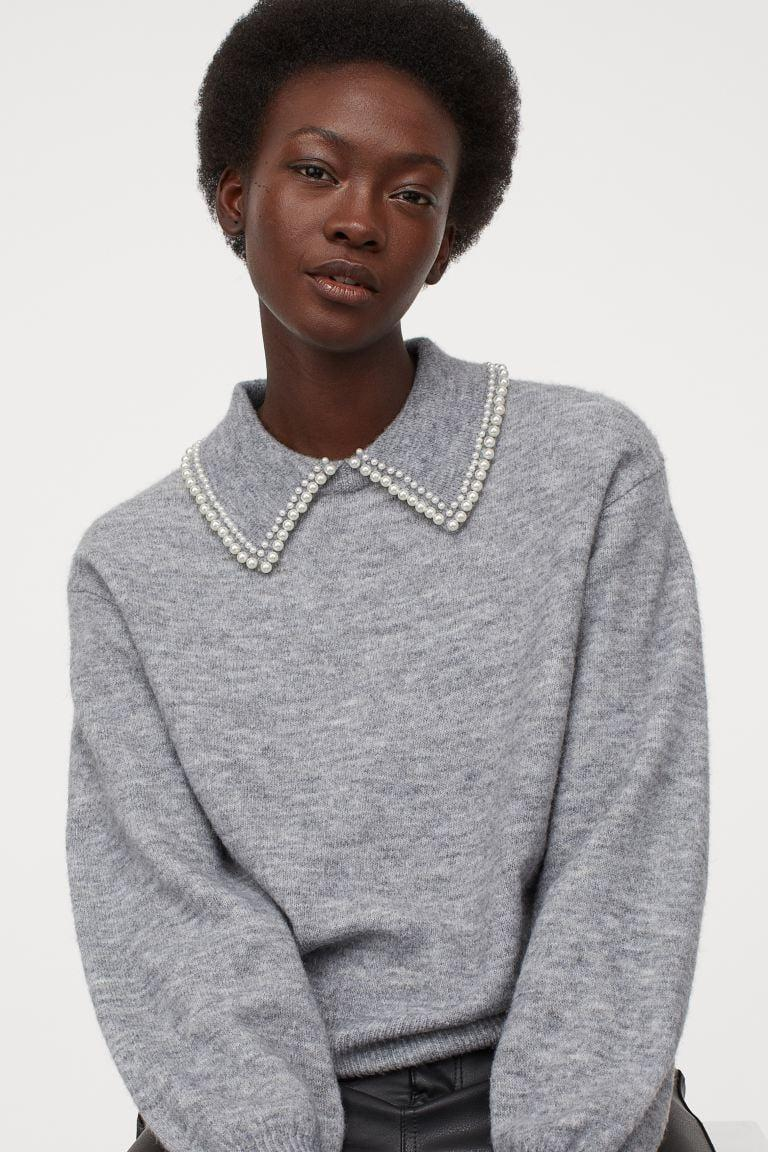 <p>The little embellishment on this <span>H&M Collared Sweater</span> ($30) is so fun and perfect for Zoom calls.</p>