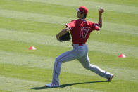 Los Angeles Angels designated hitter Shohei Ohtani (17) pitches during a baseball practice at Angels Stadium on Friday, July 3, 2020, in Anaheim, Calif. (AP Photo/Ashley Landis)