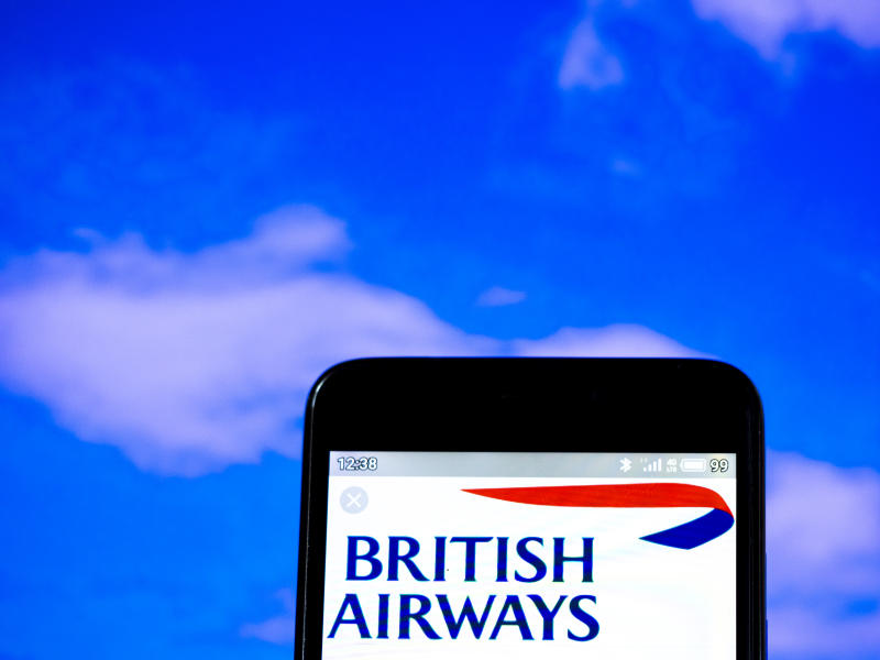 In this photo illustration the British Airways plc logo is seen displayed on a smartphone. Photo by Igor Golovniov/SOPA Images/LightRocket via Getty Images