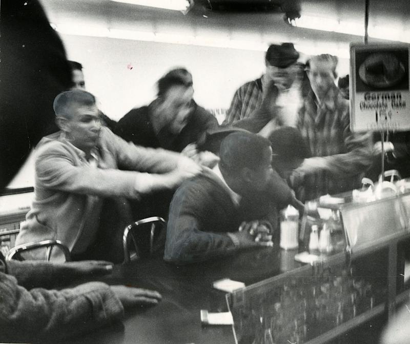 John Lewis is pulled off a stool during a sit-in at a segregated lunch counter in Nashville, Tenn., in the 1960s.