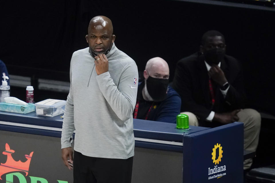 Atlanta Hawks coach Nate McMillan watches during the first half of the team's NBA basketball game against the Indiana Pacers on Thursday, May 6, 2021, in Indianapolis. (AP Photo/Darron Cummings)
