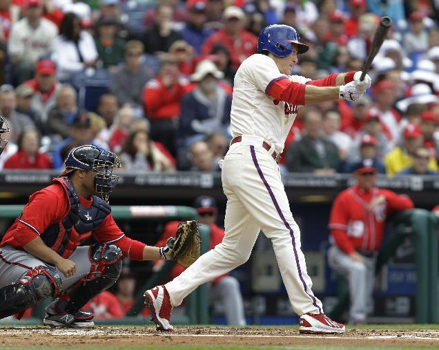 Philadelphia Phillies' Chase Utley, right, connects on an RBI-single to bring home Jimmy Rollins in the first inning of a baseball game against the Washington Nationals, Sunday, May 4, 2014, in Philadelphia. (AP Photo/Laurence Kesterson)