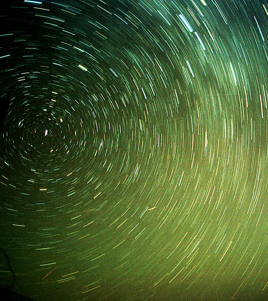 A meteor (bottom L) streaks past stars, which light up the night sky over the al-Azraq desert in Jordan in the early hours of December 14, 2004. The shower, named Geminid because it appears to originate from the constellation Gemini, lit up the sky with dozens of shooting stars per hour. (Picture taken with 400 Asa film with 10 minute exposure) NO RIGHTS CLEARANCES OR PERMISSIONS ARE REQUIRED FOR THIS IMAGE. REUTERS/Ali Jarekji  AJ/AA