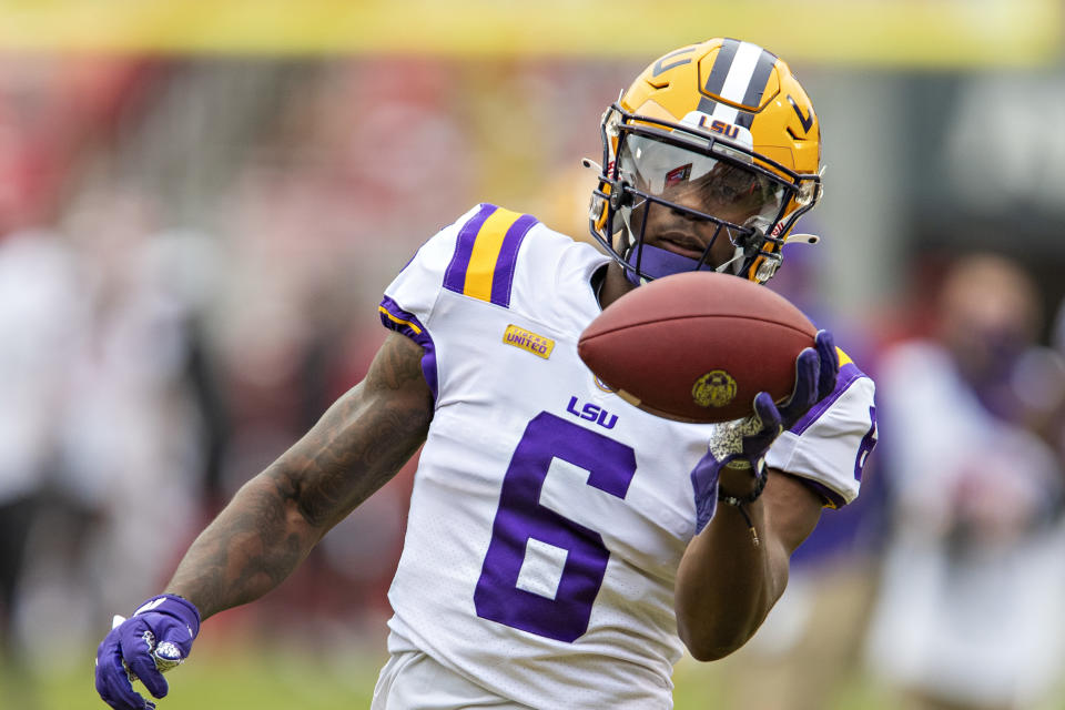 FAYETTEVILLE, AR - NOVEMBER 21:  Terrace Marshall Jr. #6 of the LSU Tigers warms up before a game against the Arkansas Razorbacks at Razorback Stadium on November 21, 2020 in Fayetteville, Arkansas.  The Tigers defeated the Razorbacks 27-24.  (Photo by Wesley Hitt/Getty Images)