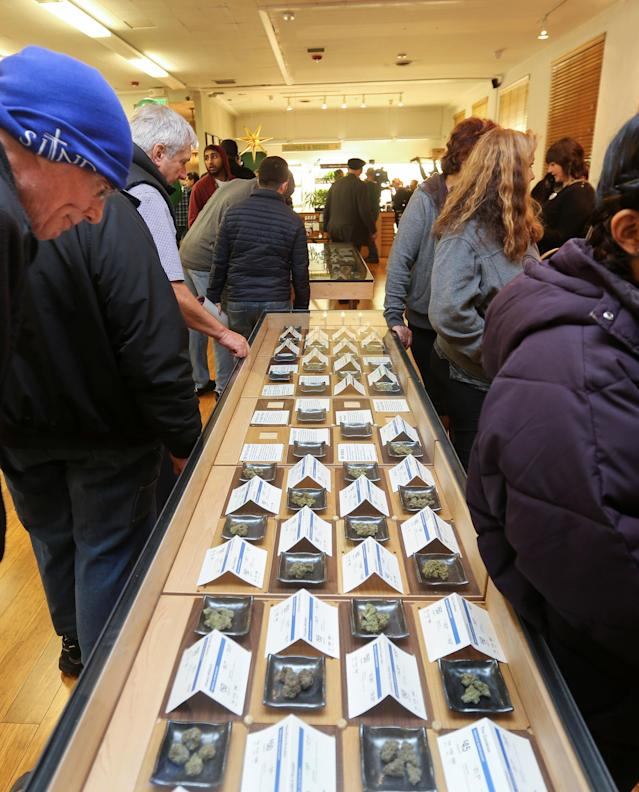 <p>A customer peers at different marijuana strains in a glass case at Harborside, one of California's largest and oldest dispensaries of medical marijuana, on the first day of legalized recreational marijuana in Oakland, Calif., Jan. 1, 2018. (Photo: Elijah Nouvelage/Reuters) </p>