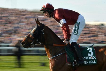 Horse Racing - Grand National Festival - Aintree Racecourse, Liverpool, Britain - April 6, 2019 Tiger Roll ridden by Davy Russell during the 5.15 Randox Health Grand National Handicap Chase REUTERS/Peter Powell
