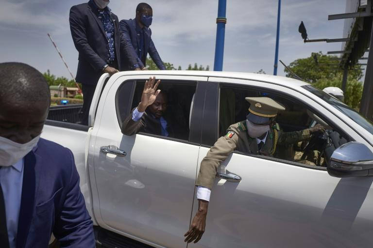 Coup leader Goita waves as he returns to Mali from and ECOWAS crisis summit in Ghana
