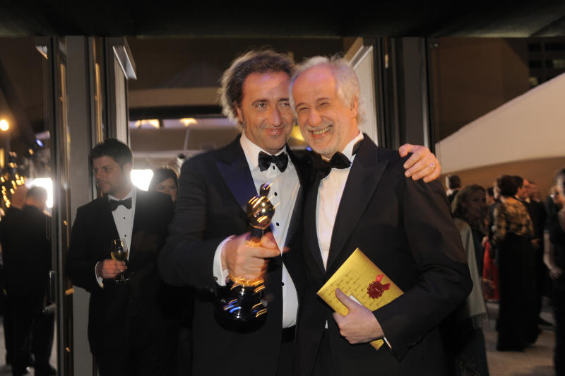 "Paolo Sorrentino, left, poses with the award for best foreign language film of the year for ""The Great Beauty"" with Toni Servillo at the Governors Ball after the Oscars on Sunday, March 2, 2014, at the Dolby Theatre in Los Angeles. (Photo by Chris Pizzello/Invision/AP)"