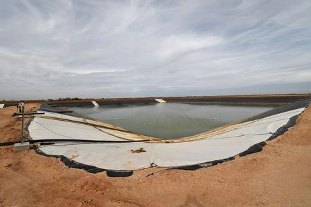 A water storage pond is seen at a wastewater injection facility operated by H20 Midstream in Big Spring, Texas U.S. February 13, 2019. Picture taken February 13, 2019.  REUTERS/Nick Oxford