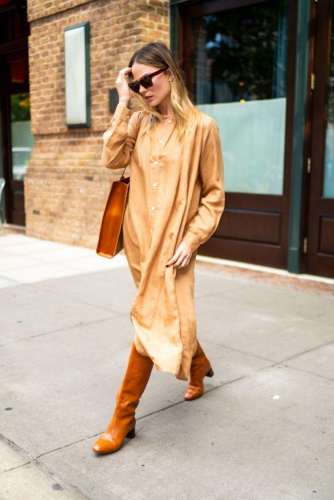 """<p>The 29-year-old opted for a biscuit-hued ensemble whilst out in New York, with matching tan boots and bag and a sand-coloured dress by MILLE.</p><p>MILLE, Jasmine Dress in Almond, £188</p><p><a class=""""link rapid-noclick-resp"""" href=""""https://shopmille.com/collections/new-arrivals/products/jasmine-dress-in-almond"""" rel=""""nofollow noopener"""" target=""""_blank"""" data-ylk=""""slk:SHOP NOW"""">SHOP NOW</a></p>"""