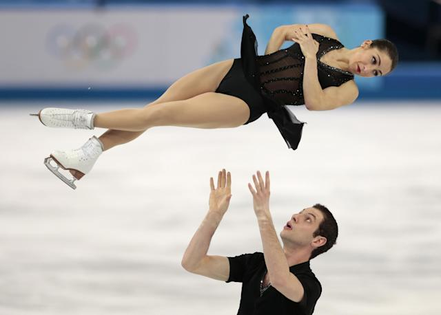 Marissa Castelli and Simon Shnapir of the United States compete in the pairs short program figure skating competition at the Iceberg Skating Palace during the 2014 Winter Olympics, Tuesday, Feb. 11, 2014, in Sochi, Russia. (AP Photo/Ivan Sekretarev)