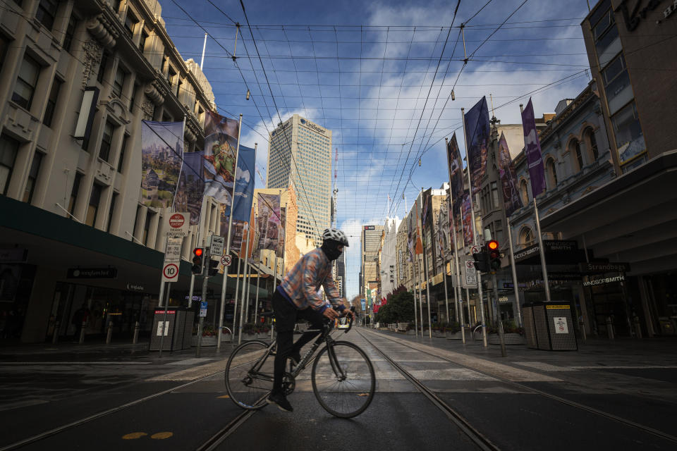 A bike rider on the empty streets at Bourke Street in Melbourne.