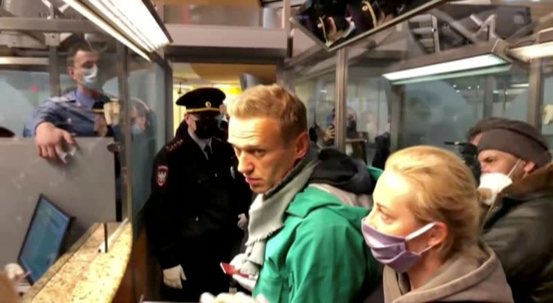 FILE PHOTO: Police officers detain Russian opposition politician Alexei Navalny in Moscow