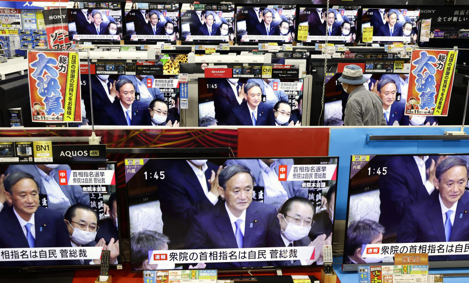 TV sets show a live footage of Yoshihide Suga as he is elected as Japan's new prime minister, at an electric store in Fukuoka, southern Japan Wednesday, Sept. 16, 2020. Japan's Parliament elected Suga as prime minister Wednesday, replacing long-serving leader Shinzo Abe with his right-hand man. (Kyodo News via AP)