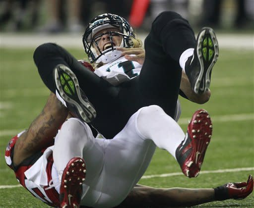 Atlanta Falcons defensive end John Abraham (55) sacks Jacksonville Jaguars quarterback Blaine Gabbert (11) during the first half of an NFL football game Thursday, Dec. 15, 2011, in Atlanta. (AP Photo/John Bazemore)