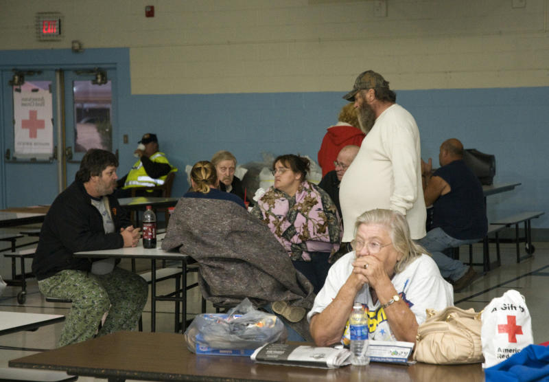 Residents of West Point, Ky., living within a mile-and-a-half radius of the site of a train derailment wait at a Red Cross shelter Wednesday, Oct. 31, 2012 at the Muldraugh Elementary School in Muldraugh, Ky. A Paducah & Louisville Railway train carrying hazardous chemicals derailed just after 6 a.m. EDT Monday, A leak of a potentially explosive material was contained, but authorities say three workers were severely burned in a fire that erupted while contractors were removing debris from the train today in southwest Louisville, Kentucky. (AP Photo/Brian Bohannon)