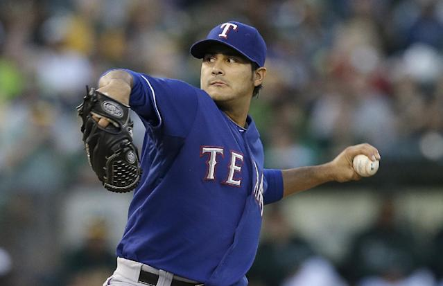 Texas Rangers pitcher Martin Perez throws against the Oakland Athletics in the first inning of a baseball game in Oakland, Calif., Tuesday, Sept. 3, 2013. (AP Photo/Jeff Chiu)