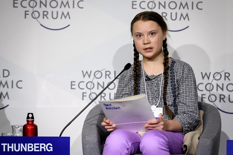 "Swedish youth climate activist Greta Thunberg (C) delivers a mesage on climate change at Davos that business executives called ""moving"" and ""inspiring"" (AFP Photo/Fabrice COFFRINI)"