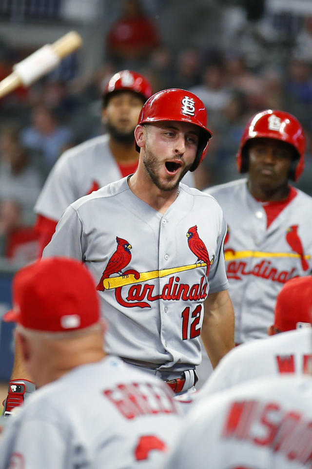 St. Louis Cardinals' Paul DeJong (12) celebrates a two-run home run with teammates in the fourth inning of a baseball game against the Atlanta Braves, Tuesday, Sept. 18, 2018, in Atlanta. (AP Photo/Todd Kirkland)