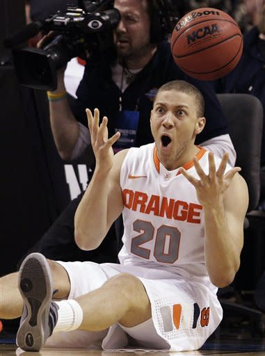 Syracuse guard Brandon Triche (20) reacts after landing on the floor during the first half of the East Regional final game against Ohio State in the NCAA men's college basketball tournament, Saturday, March 24, 2012, in Boston. (AP Photo/Michael Dwyer)