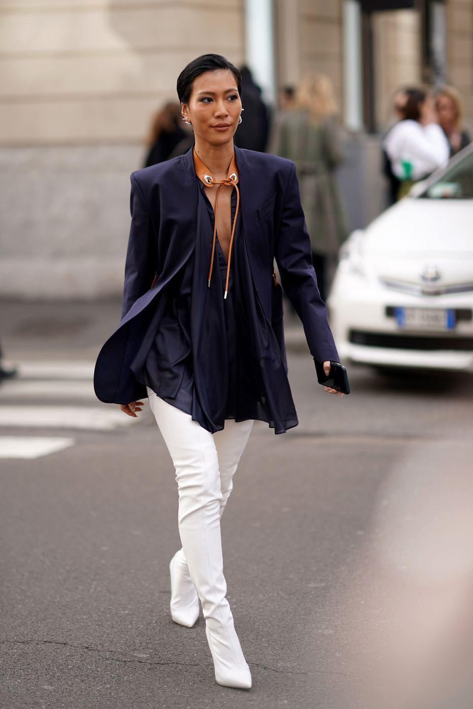 <p>A top with a cutout or a revealing neckline really amps up your look. Bright-white boots will definitely get you noticed when you're walking down the sidewalk. (Just make sure they don't get scuffed!) </p>