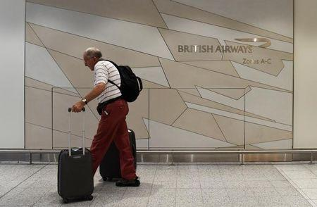 A man arrives at the British Airways check-in desk at Gatwick Airport in southern England