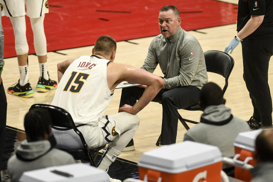 PORTLAND, OR - MAY 29: Nikola Jokic (15) and Denver Nuggets head coach Michael Malone strategize against the Portland Trail Blazers during the first quarter at Moda Center on Saturday, May 29, 2021. (Photo by AAron Ontiveroz/MediaNews Group/The Denver Post via Getty Images)