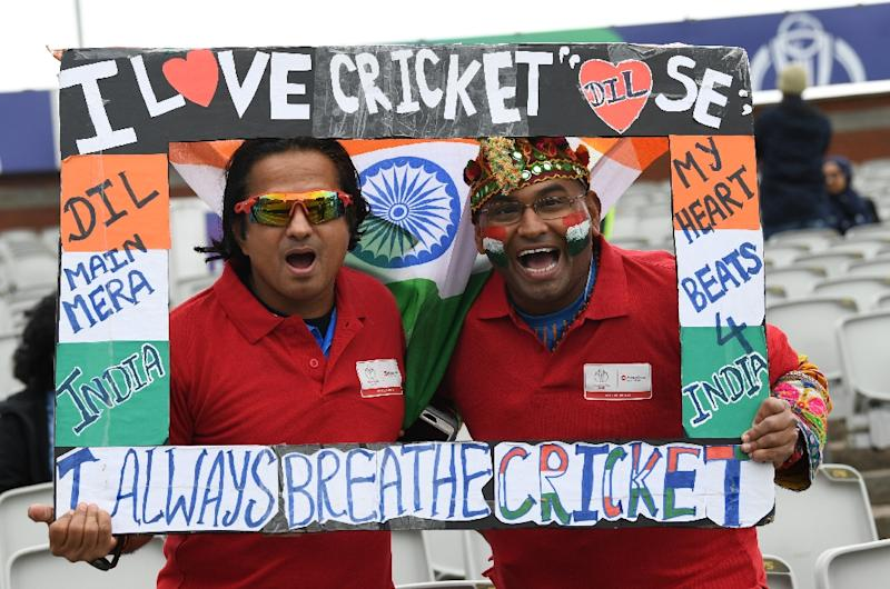 Indian supporters pose ahead of the Cricket World Cup match between India and Pakistan at Old Trafford (AFP Photo/Paul ELLIS)